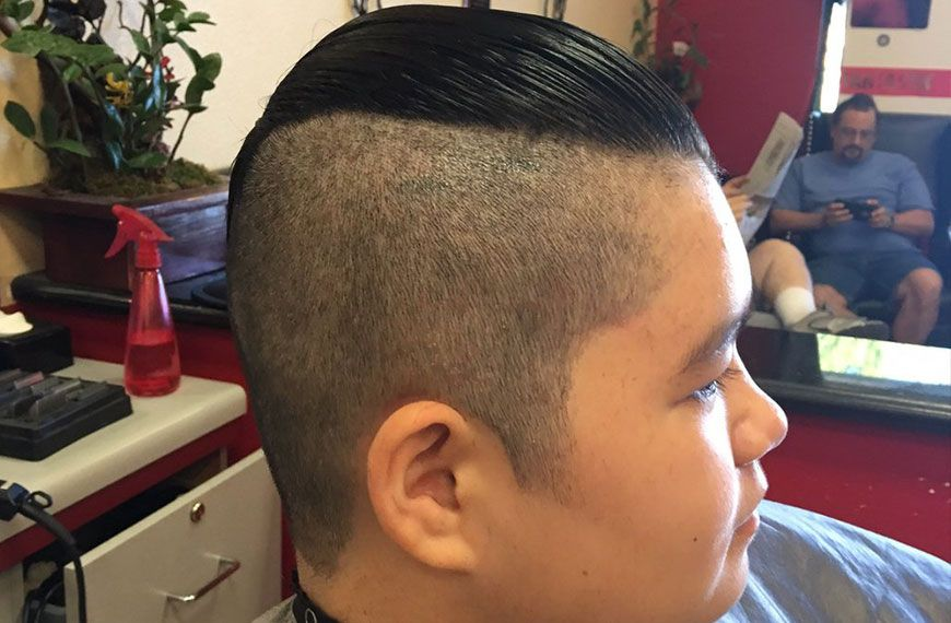 Teen with a ducktail haircut on gallery