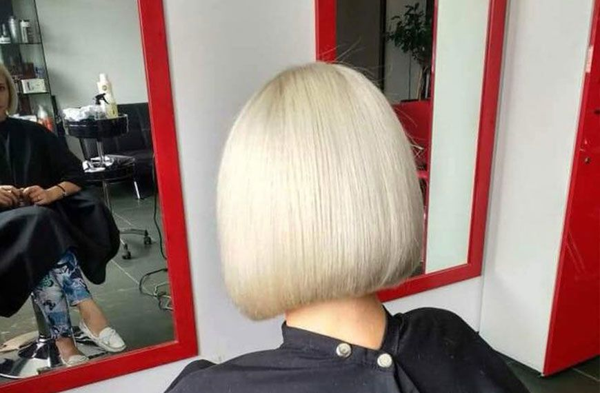 Lady with a woman's haircut on gallery